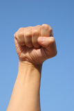 Charge!. Man's fist in the air Royalty Free Stock Photos