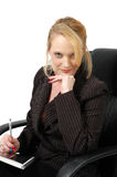 In Charge. Woman sits with chin on hand and pen in the other. Woman in charge Stock Images