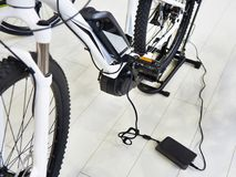 Charge battery electric bike. Charge the battery electric bike stock image