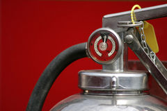 Charged. Top of a fire extinguisher showing the pressure gauge with  a full charge Royalty Free Stock Images