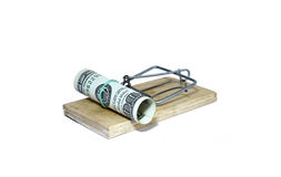 Charged mousetrap with bait in the form of hundred dollar bills. Isolated Royalty Free Stock Image