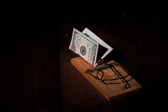 Charged mousetrap money Stock Image