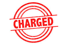 CHARGED Rubber Stamp. Over a white background Stock Photos
