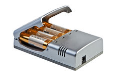 Charger for accumulators isolated. Stock Photo