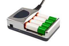Charger with battery Stock Image