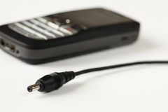 Charger and cell phone Stock Images