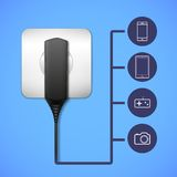 Charger into an electrical outlet. Electronic gadget closeup. Flat icons with gadget views Stock Photography