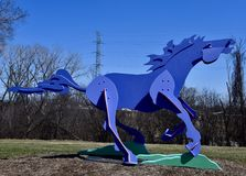 Charger II. This is an early Spring picture of a piece of public art titled: Charger II, on display at the Skokie Northshore Sculpture Park located in Skokie Royalty Free Stock Photography