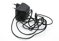 Charger for phone. Black charger for mobile phone Royalty Free Stock Photos