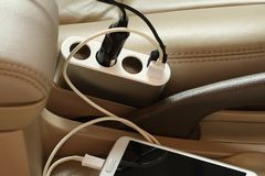 Charger plug in a car. Charger plug is charging smartphone in a car royalty free stock images