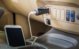Charger plug phone. On car stock photography