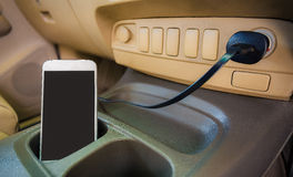 Charger plug phone on car. Charger plug phone on car stock images
