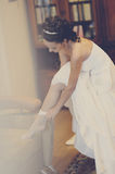 Charges the bride and dress up wedding gown Royalty Free Stock Images