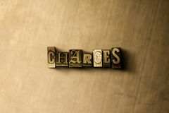 CHARGES - close-up of grungy vintage typeset word on metal backdrop Stock Photo
