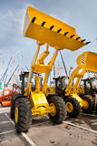 Chargeur de frontal diesel jaune photographie stock