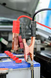 Charging battery car with jumper cables Stock Image