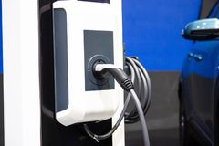 The charging the battery for the car new Automotive Innovations the power supply. Plugged into an electric car being charged, concept of energy innovation royalty free stock photos