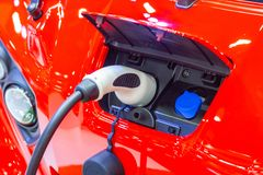 The charging the battery for the car new Automotive Innovations the power supply plugged. Into an electric car being charged, concept of energy innovation royalty free stock photo