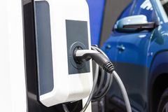 The charging the battery for the car new Automotive Innovations the power supply plugged. Into an electric car being charged, concept of energy innovation royalty free stock images