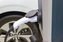 The charging the battery for the car new Automotive Innovations the power supply. Plugged into an electric car being charged, concept of energy innovation royalty free stock image