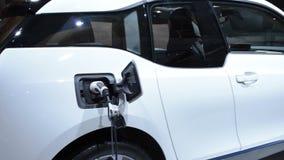 Charging BMW i3 urban electric car stock video