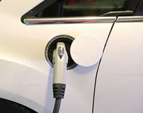 Charging a car. Charging the battery of an electric car Royalty Free Stock Photography