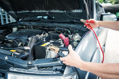 Charging car battery with electricity trough  jumper cables Stock Image