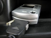 Charging cell phone. In vehicle Stock Photos