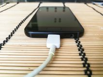 Charging. Close-up photo about a phone getting energy Stock Image