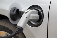 Charging an Electric Car Stock Photography