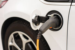 Charging electric car Royalty Free Stock Photo