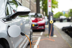 Charging an electric car. Charging an electric car - ecological way of driving Royalty Free Stock Image