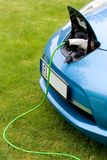 Charging an electric car Royalty Free Stock Photos