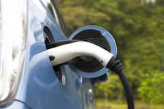 Charging of an electric car. With plug in Royalty Free Stock Photos