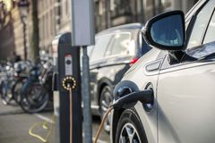 Charging an electric car in public station Royalty Free Stock Photography