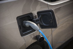 Charging an electric car Royalty Free Stock Images