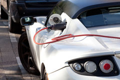 Charging of an electric sports car Stock Photos