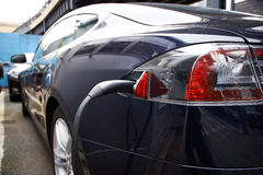 Charging electrical Motor of modern car Stock Photos
