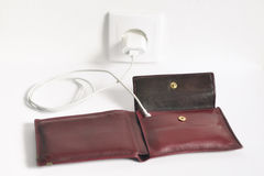 Charging an Emtpy Wallet. Funny concept of charging an empty wallet on a power socket Royalty Free Stock Images