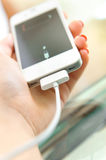 Charging of mobile phone. Stock Image