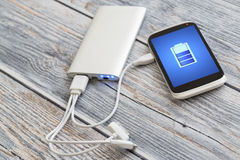 Charging of mobile phone. Royalty Free Stock Image