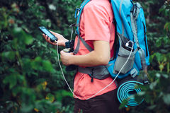 Charging mobile phone during the journey. Boy charging mobile phone during the journey Royalty Free Stock Photography