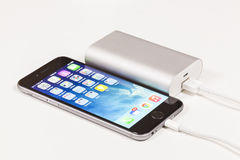 Charging a mobile phone with portable USB power Royalty Free Stock Photography