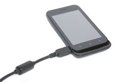 Charging mobile phone Royalty Free Stock Images