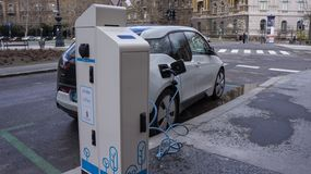 Charging modern electric cars on the street station in Budapest royalty free stock photo