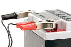 Charging motorcycle battery Stock Image