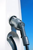 Charging plug to electric car. New charging hose in a station for electric car Royalty Free Stock Photography