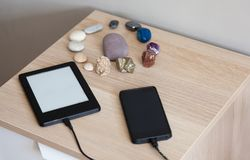 Charging portable devices at home concept stock images