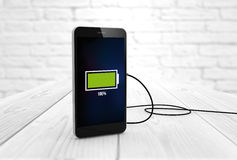 Charging smart phone Royalty Free Stock Images