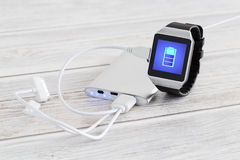 Charging of smart watch. Stock Image